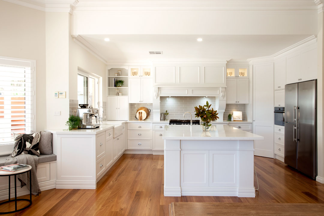 Town & Country Designs hamptons-style kitchen island bench floorboards white cabinetry